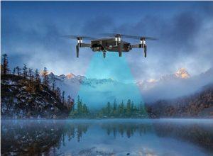 drone jjrc x12 au dessus d'un lac